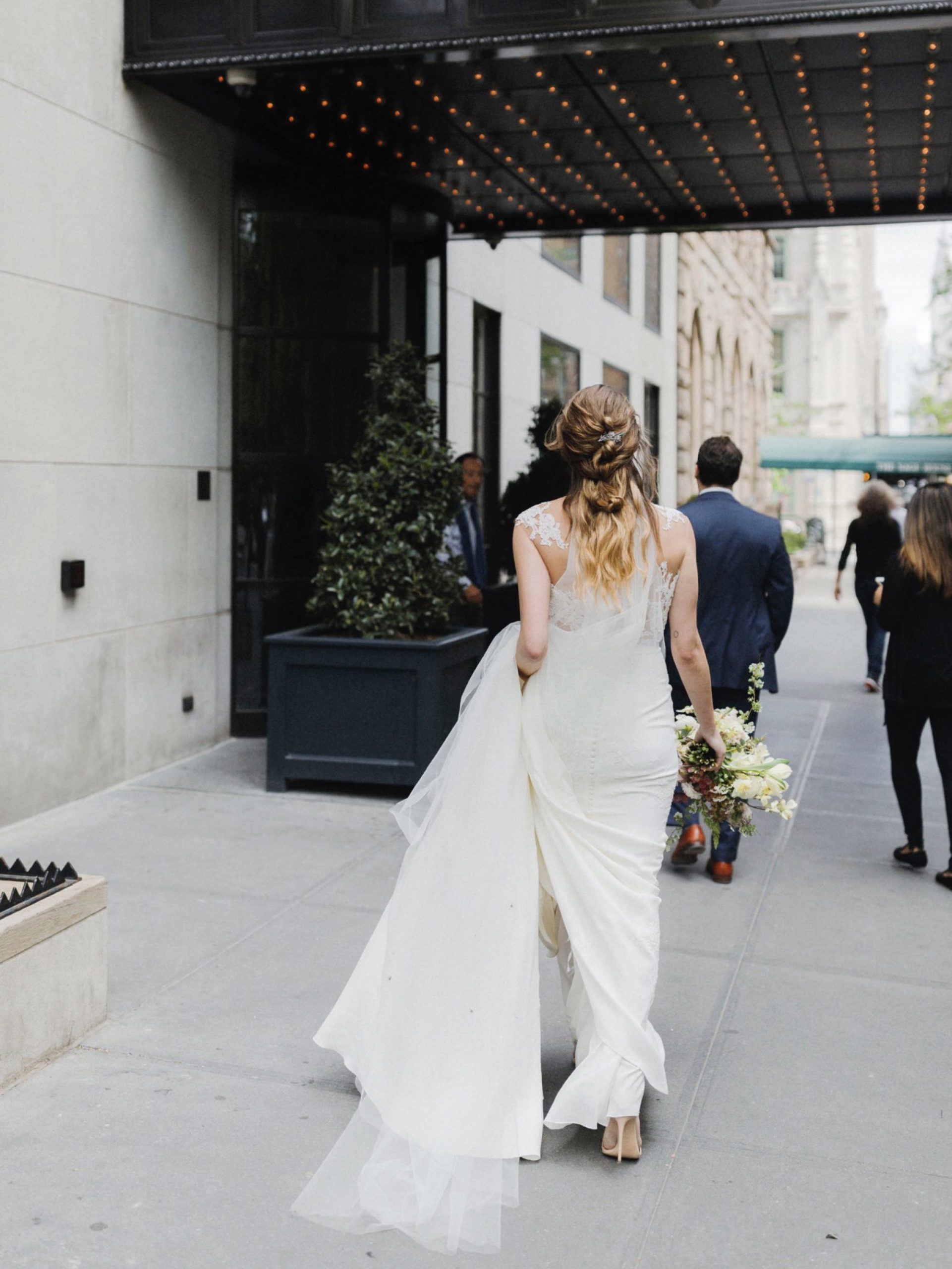 Bride walking into Gramercy Park Hotel