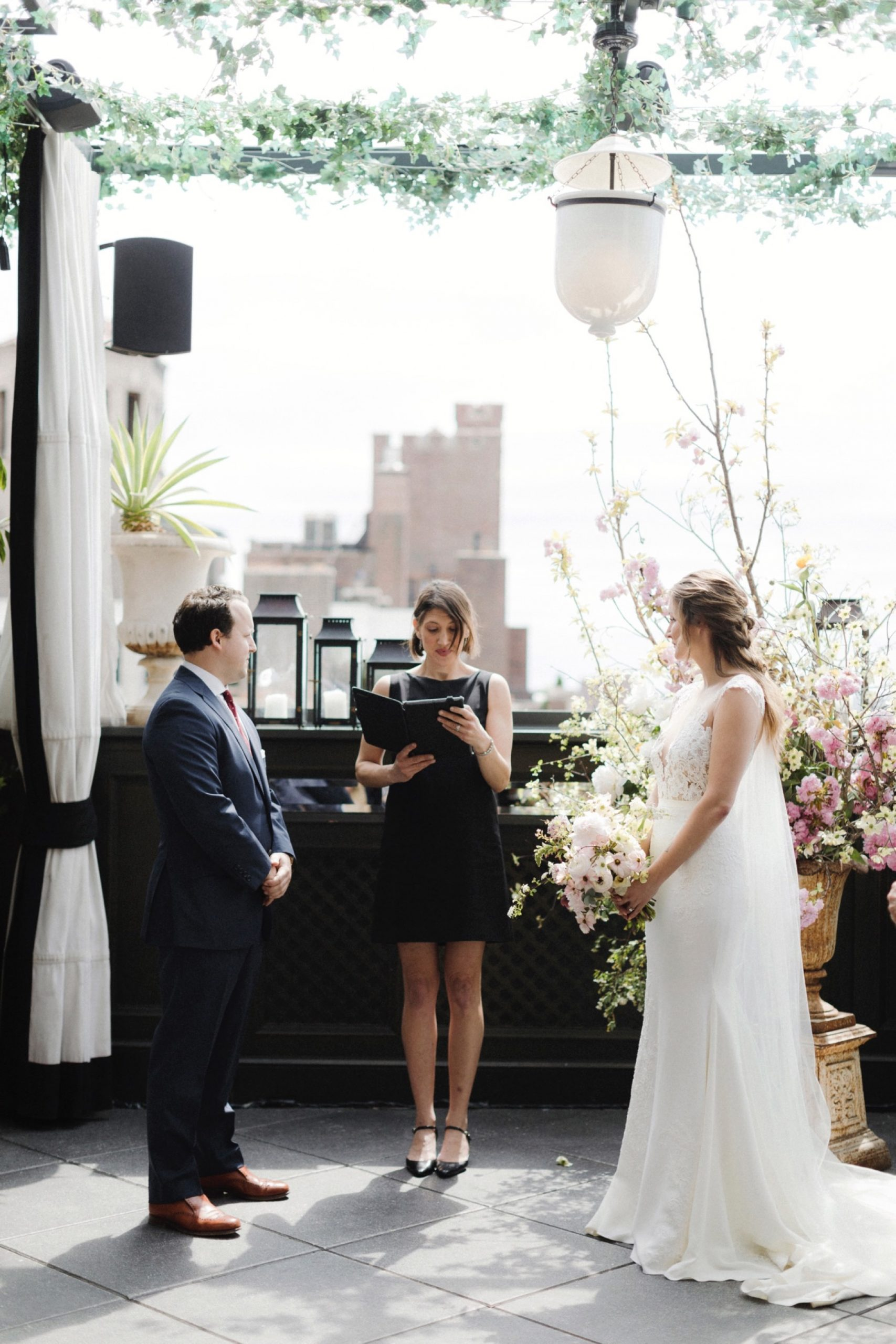 Wedding ceremony at ceremony at Gramercy terrace rooftop at ceremony at Gramercy Park Hotel