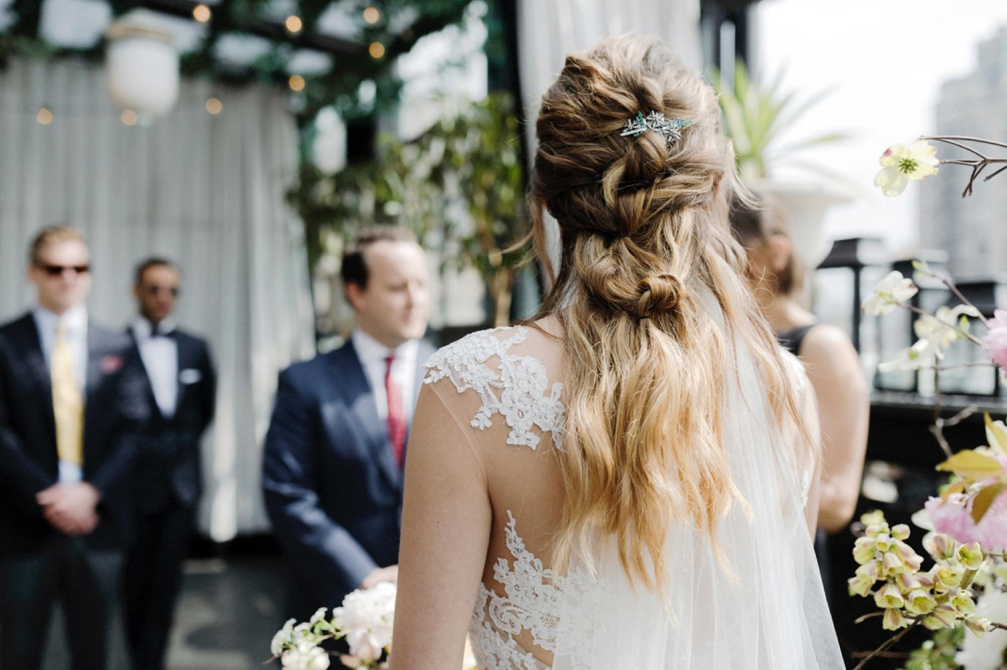 Brides hair during wedding ceremony at ceremony at Gramercy terrace rooftop at ceremony at Gramercy Park Hotel