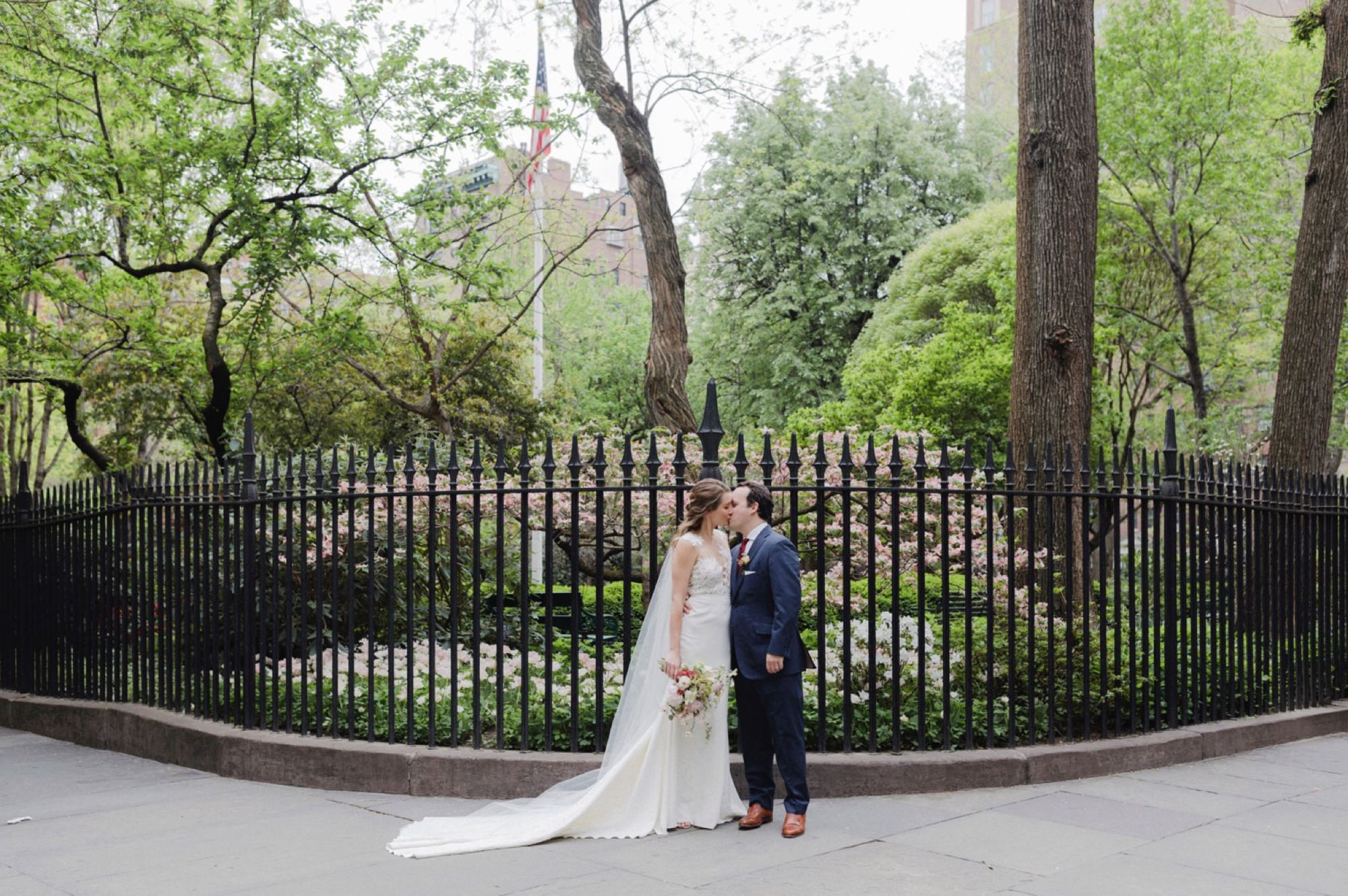 Couple kissing in front of Gramercy Park