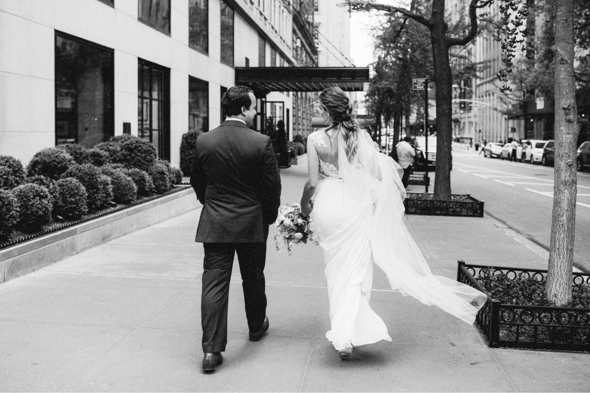 Couple walking towards Wedding couple in front of Gramercy Park Hotel