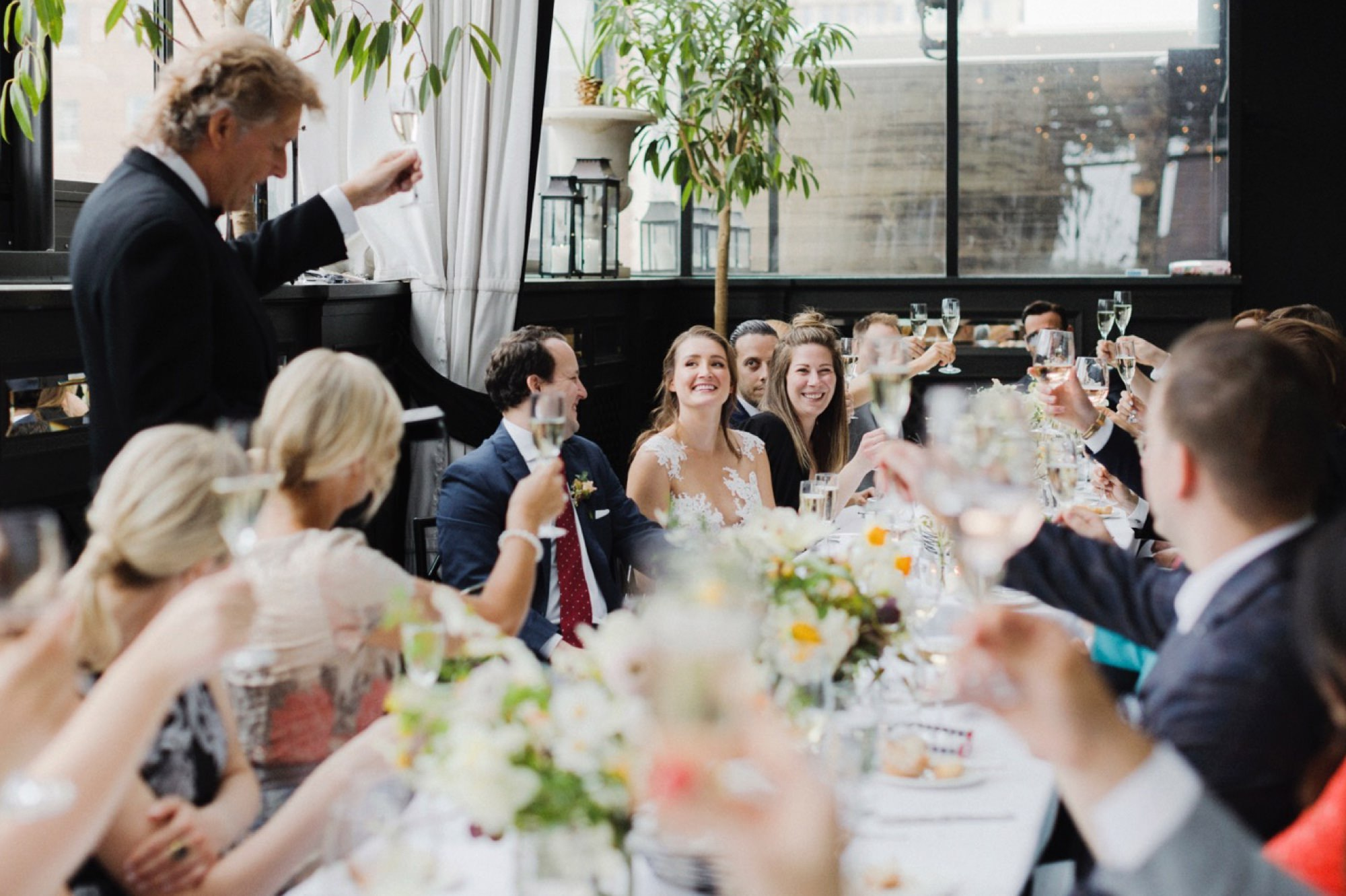 Wedding toasts at Gramercy Rooftop Wedding Venue
