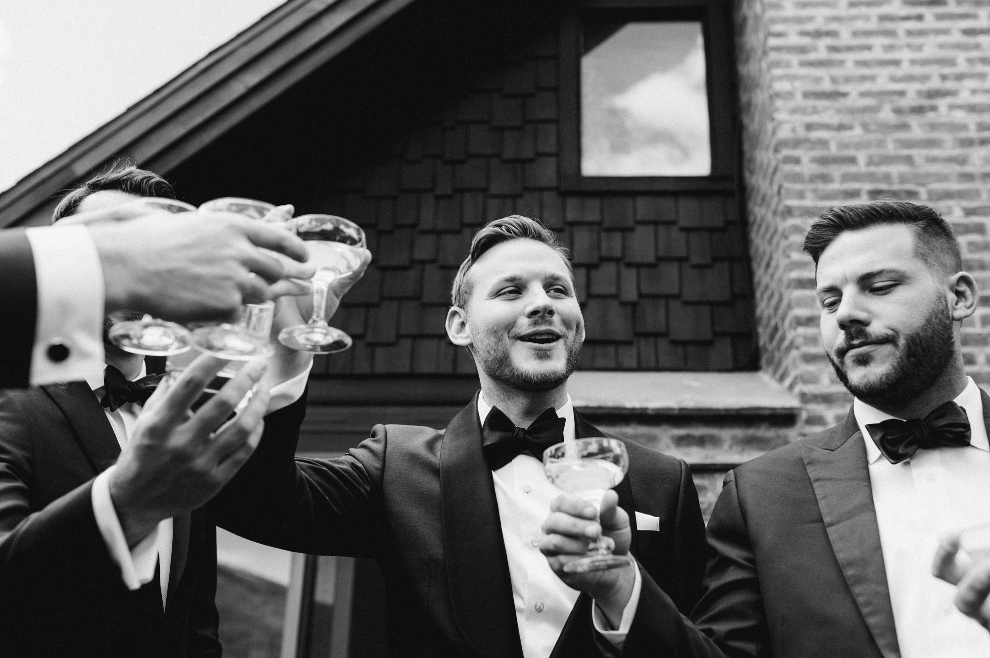 Groom with groomsman with champagne toast at Roxbury Barn Catskills New York