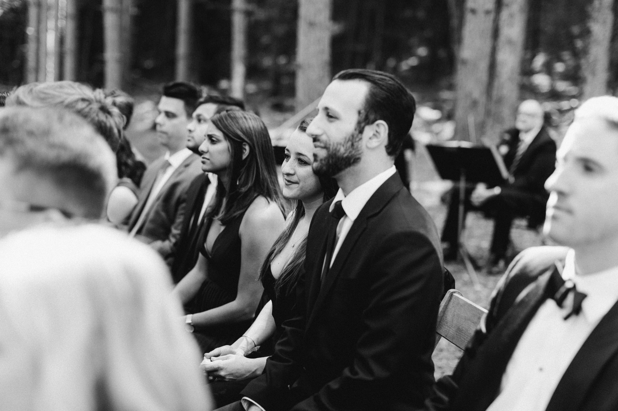 Guests at wedding ceremony at the Pine Grove location at Roxbury Barn Estate in the Catskills New York