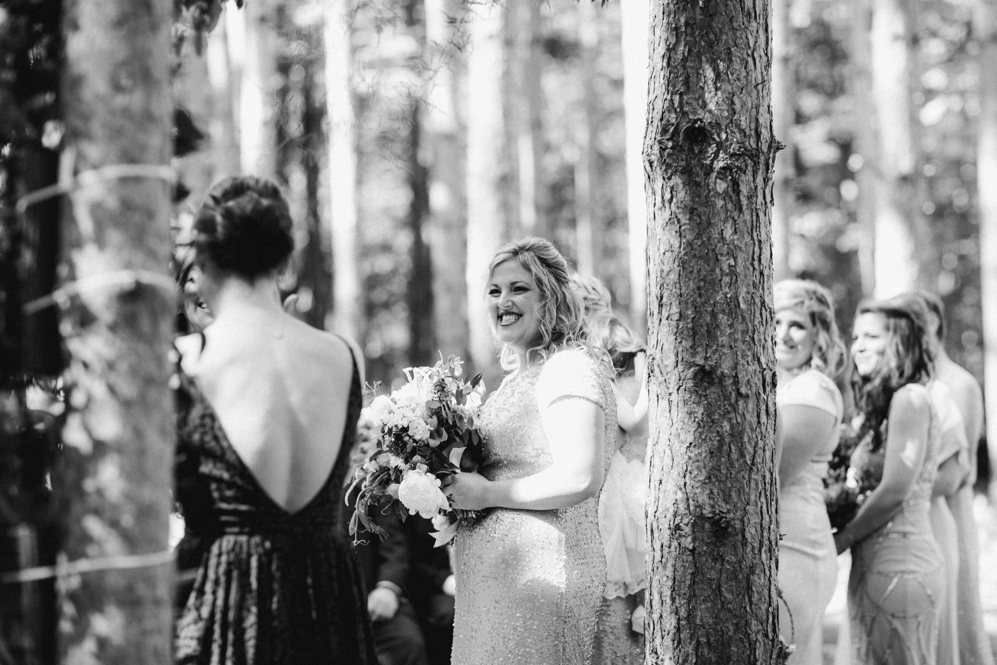 Bridesmaid at wedding ceremony at the Pine Grove location at Roxbury Barn Estate in the Catskills New York