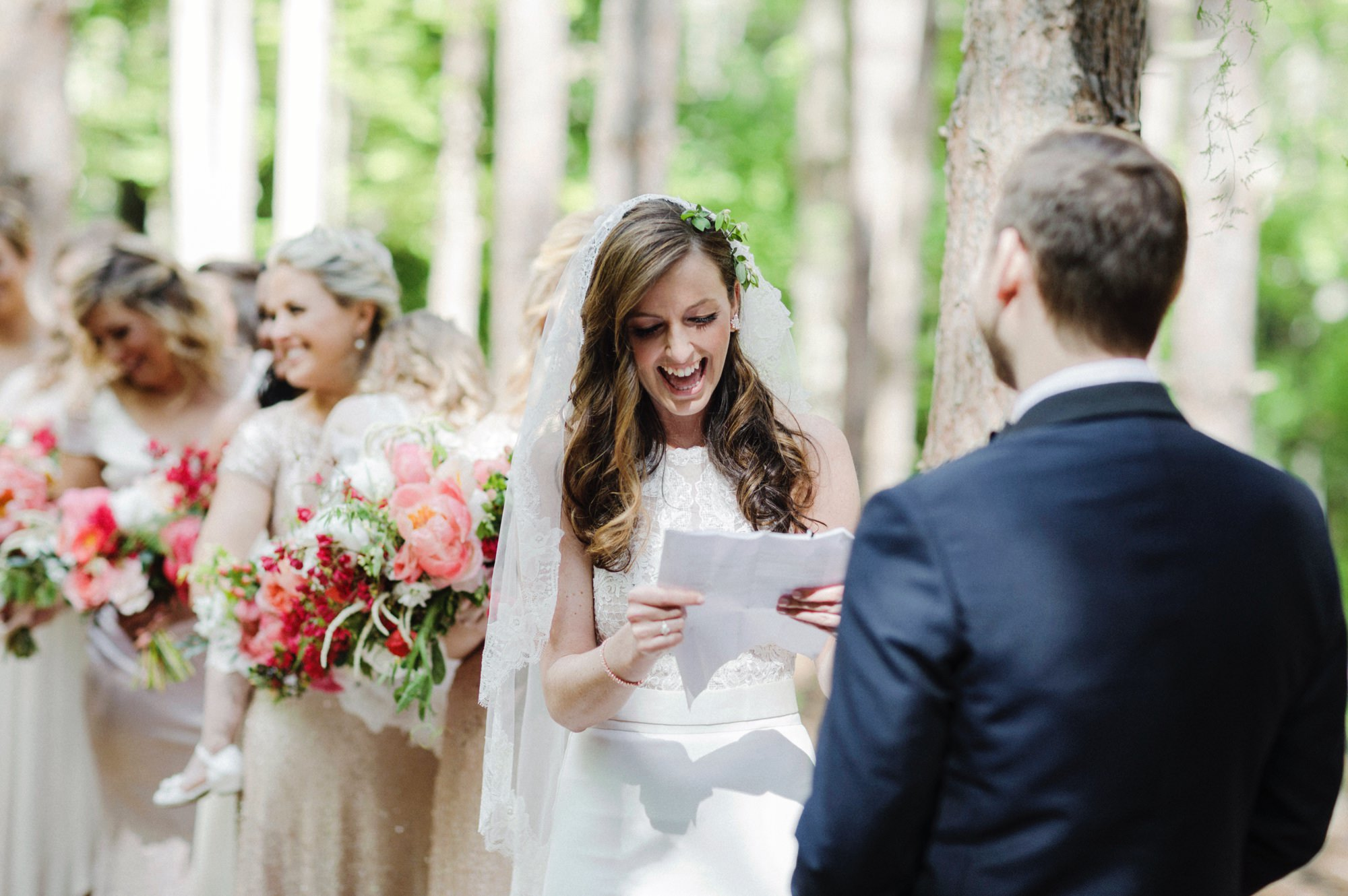 Bride reading vows at wedding ceremony at the Pine Grove location at Roxbury Barn Estate in the Catskills New York