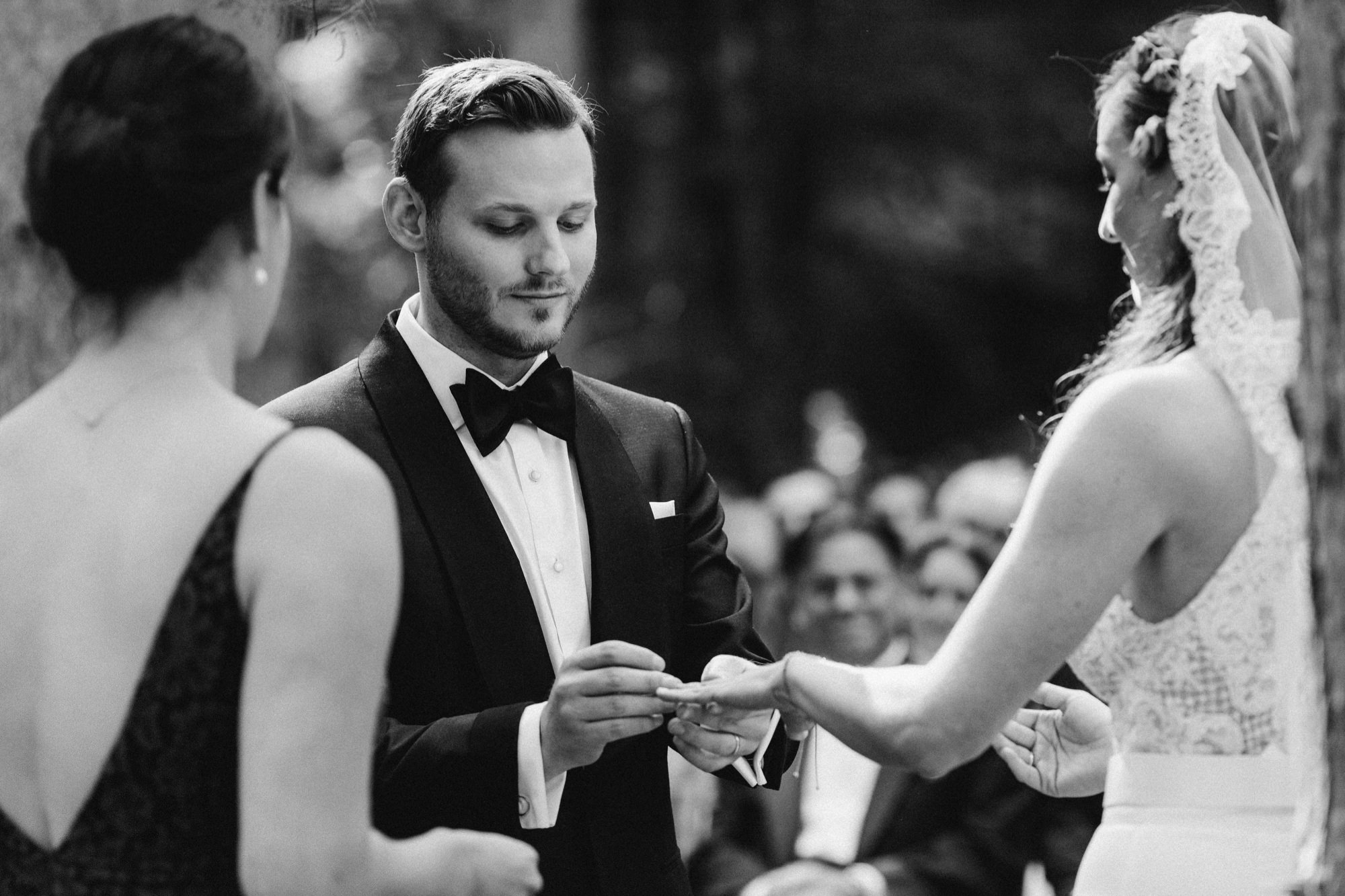 Ring exchange during wedding ceremony at the Pine Grove location at Roxbury Barn Estate in the Catskills New York