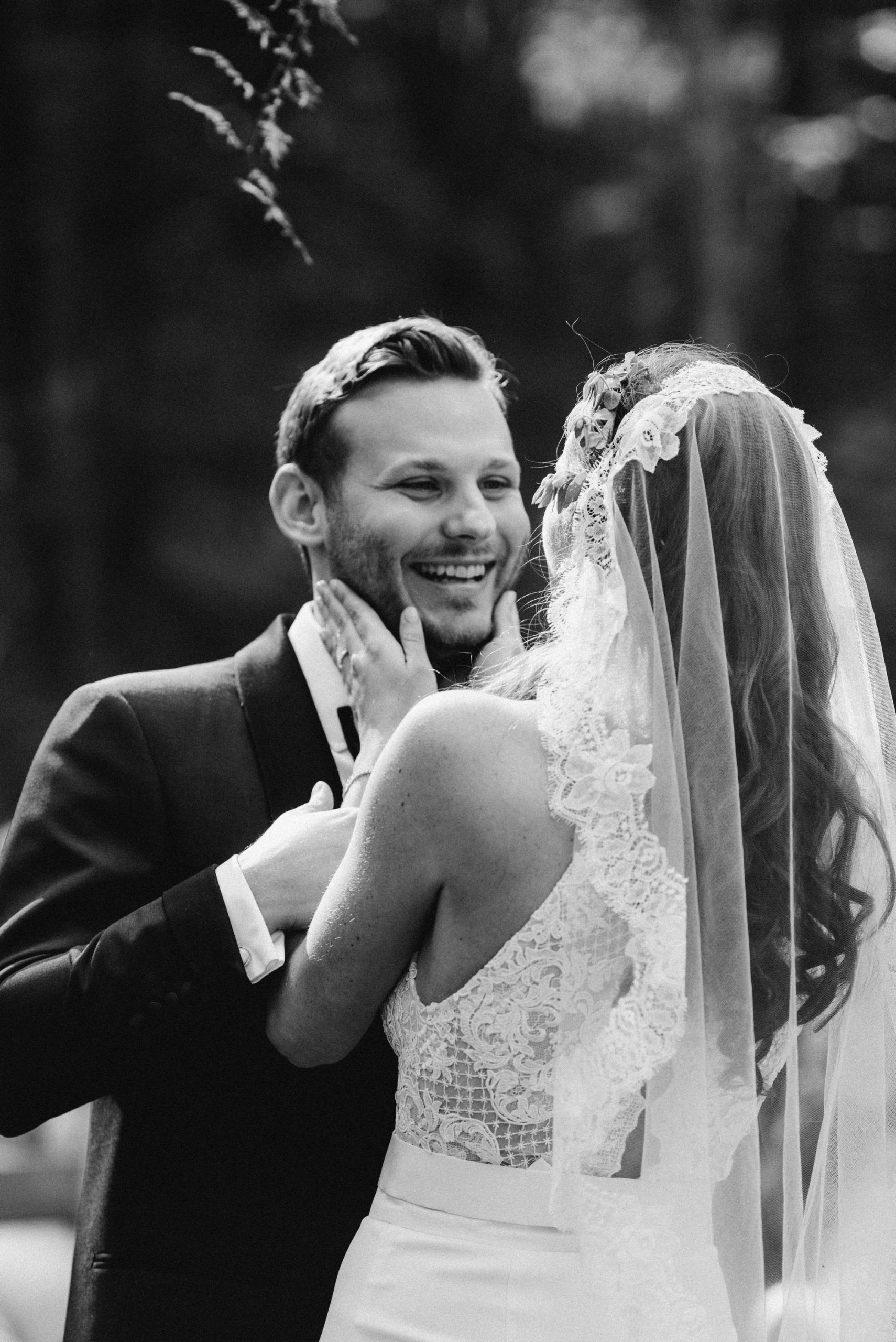 Groom smiling during wedding ceremony at the Pine Grove location at Roxbury Barn Estate in the Catskills New York