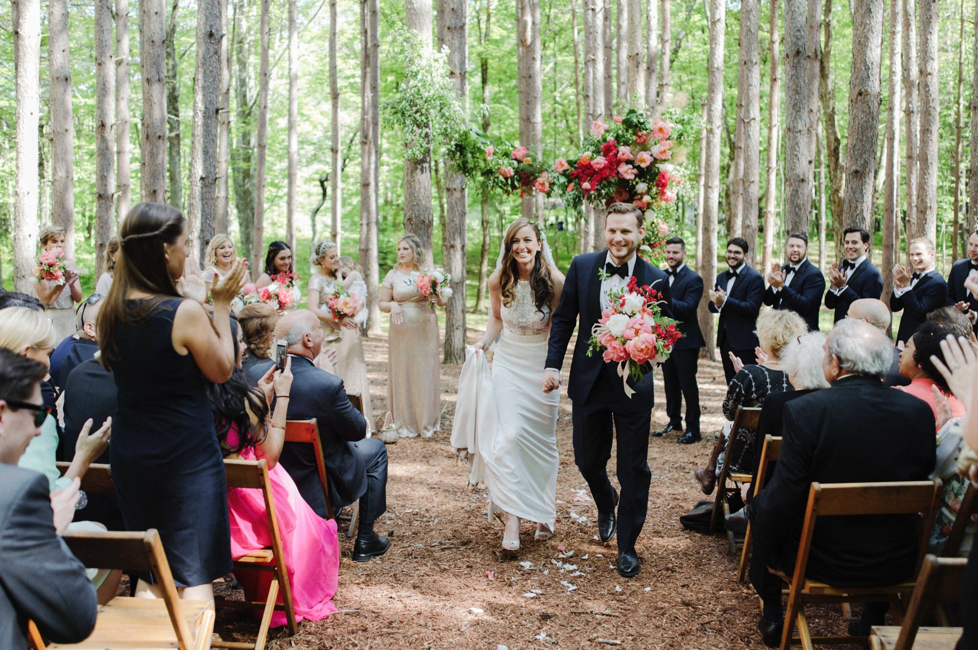 bride and groom walking back down the aisle at the Pine Grove location at Roxbury Barn Estate in the Catskills New York