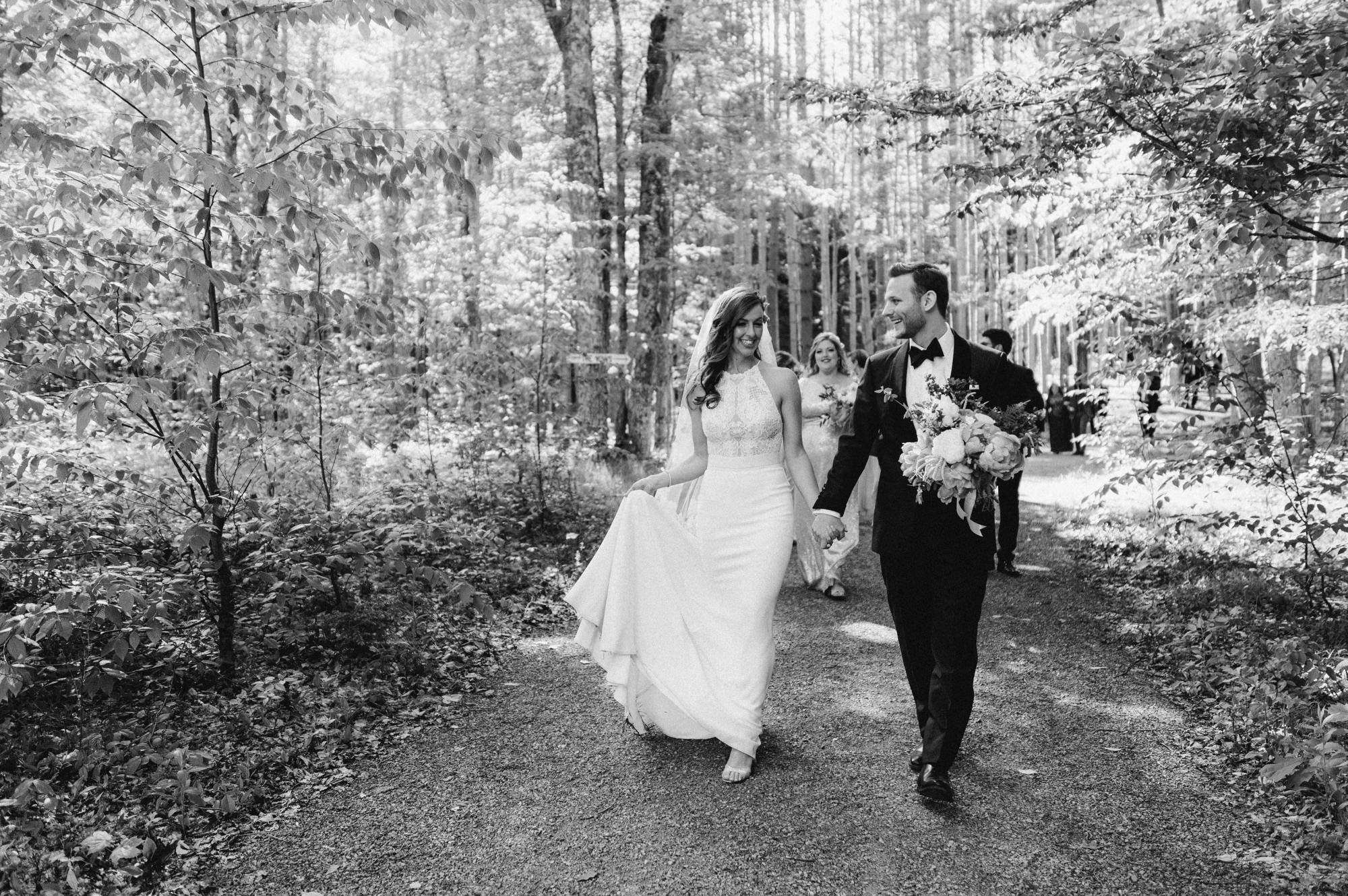bride and groom walking away from the Pine Grove location at Roxbury Barn Estate in the Catskills New York